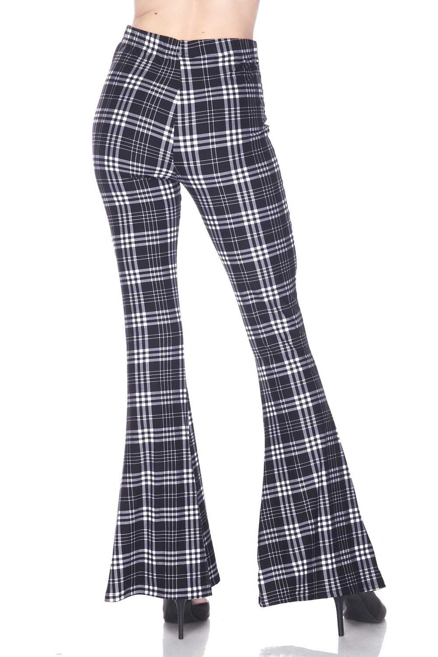 Back view of Buttery Soft Traditional Black and White Plaid Bell Bottom Leggings with a retro flared leg cut.