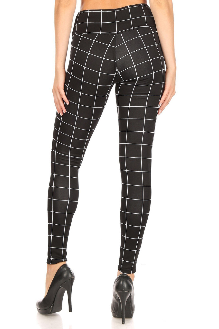 Back side image of Black and White Grid Print High Waisted Treggings with Button Front showcasing a sleek skinny leg fit.