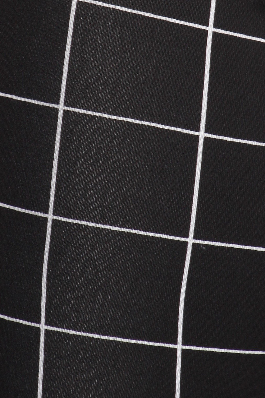 Close-up fabric swatch of Black and White Grid Print High Waisted Treggings with Button Front