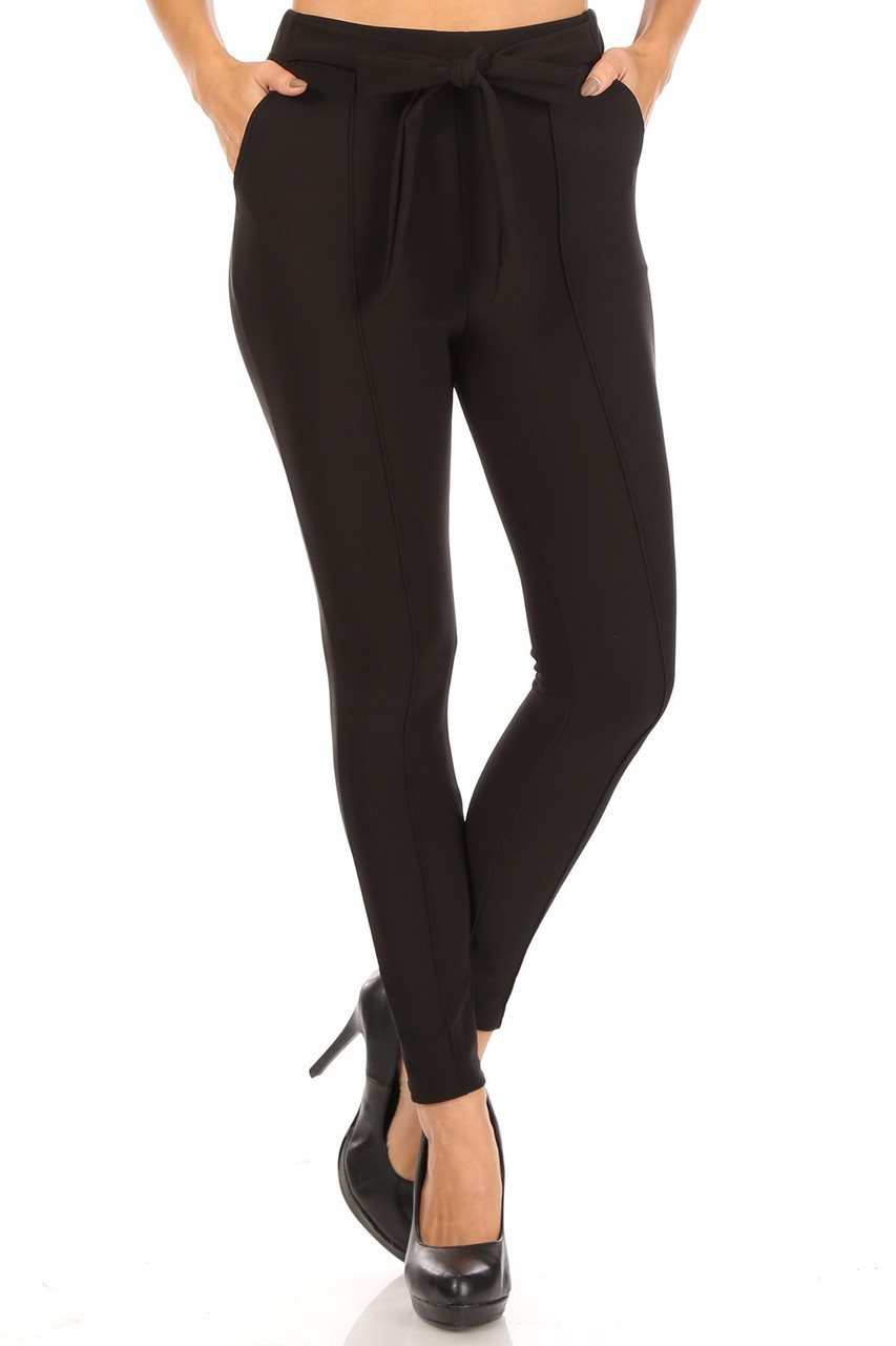 Front view of Black Scuba High Waisted Treggings with Tie Front with a sleek and chic solid toned look with bow tie detail.