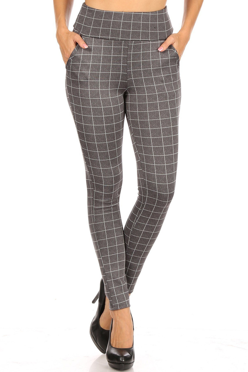 Front view of Charcoal Grid Print High Waisted Body Sculpting Treggings with Pockets with a neutral whit on gray repeating square design.
