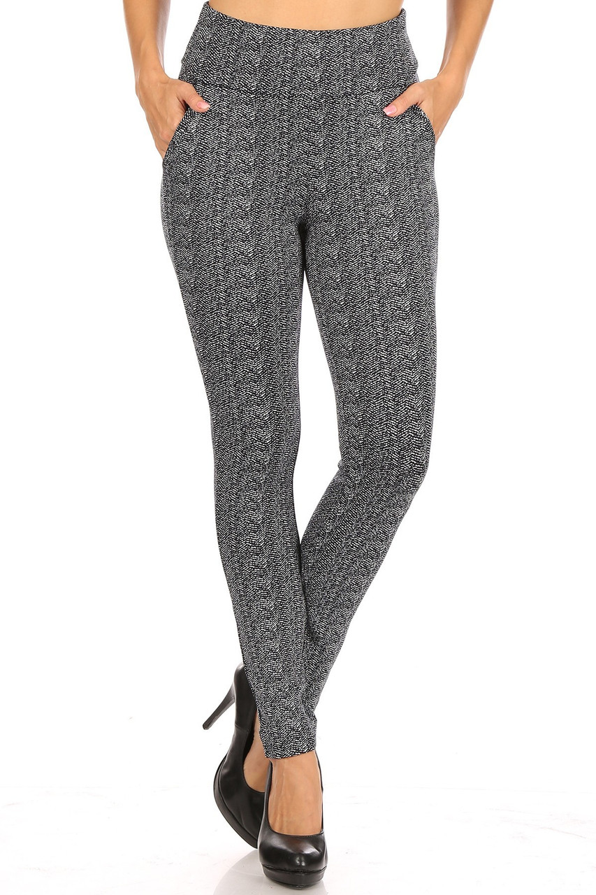 Front view of Crackled Zigzag High Waisted Body Sculpting Treggings with Pockets featuring an all over black and white chevron design.
