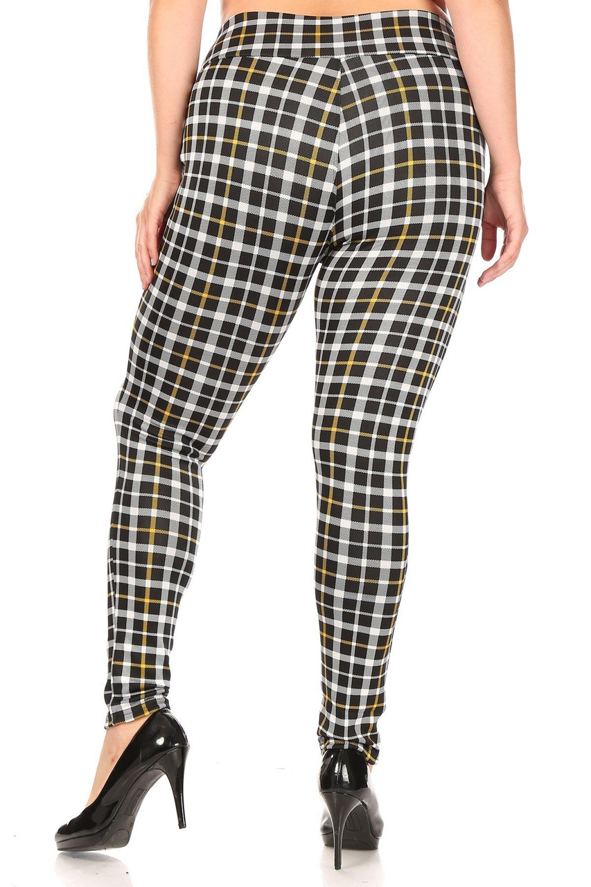 Rear view of Mustard Accent Plaid High Waisted Plus Size Treggings with Zipper Pockets showing off the skinny leg fit.