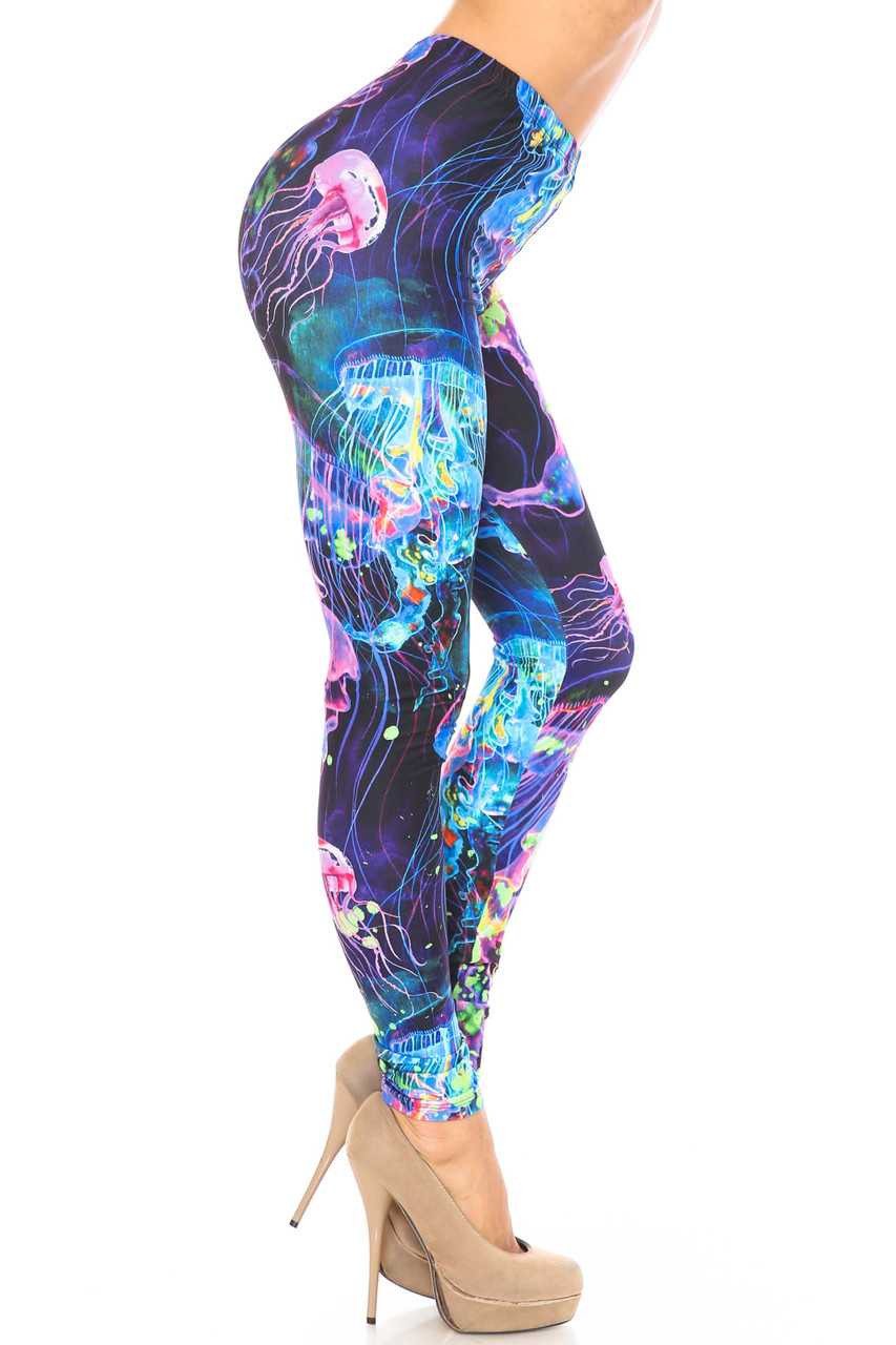 Right side view of Creamy Soft Luminous Jelly Fish Plus Size Leggings - USA Fashion™ with a fabulous glowing blue and pink jellyfish design.