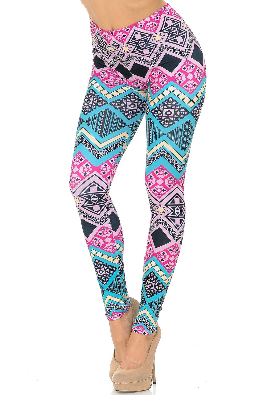 45 degree view of Creamy Soft Tasty Tribal Leggings - USA Fashion™ featuring a vibrant teal and pink tribal design.