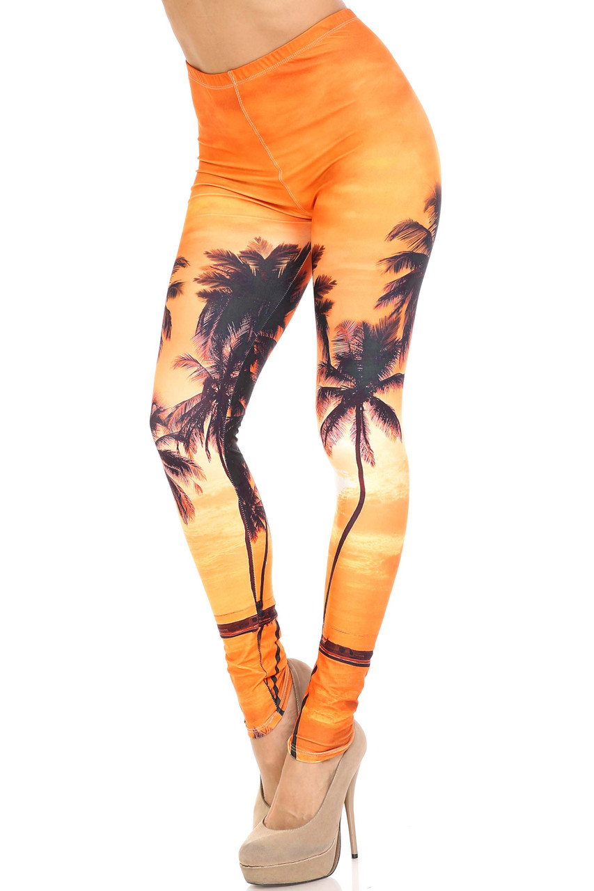 45 degree view of Creamy Soft Sunset Palm Plus Size Leggings -  USA Fashion™ with an incredible orange toned tropical scenic design with palm tree silhouettes.