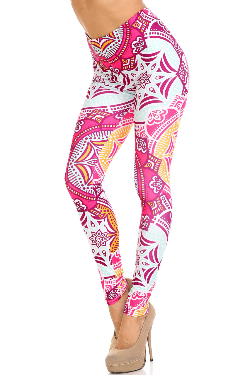 45 degree view of Creamy Soft Crimson Aquamarine Mandala Extra Plus Size Leggings - 3X-5X - USA Fashion™ with a gorgeous colorful design in a bright pink, orange, and pale blue color scheme.