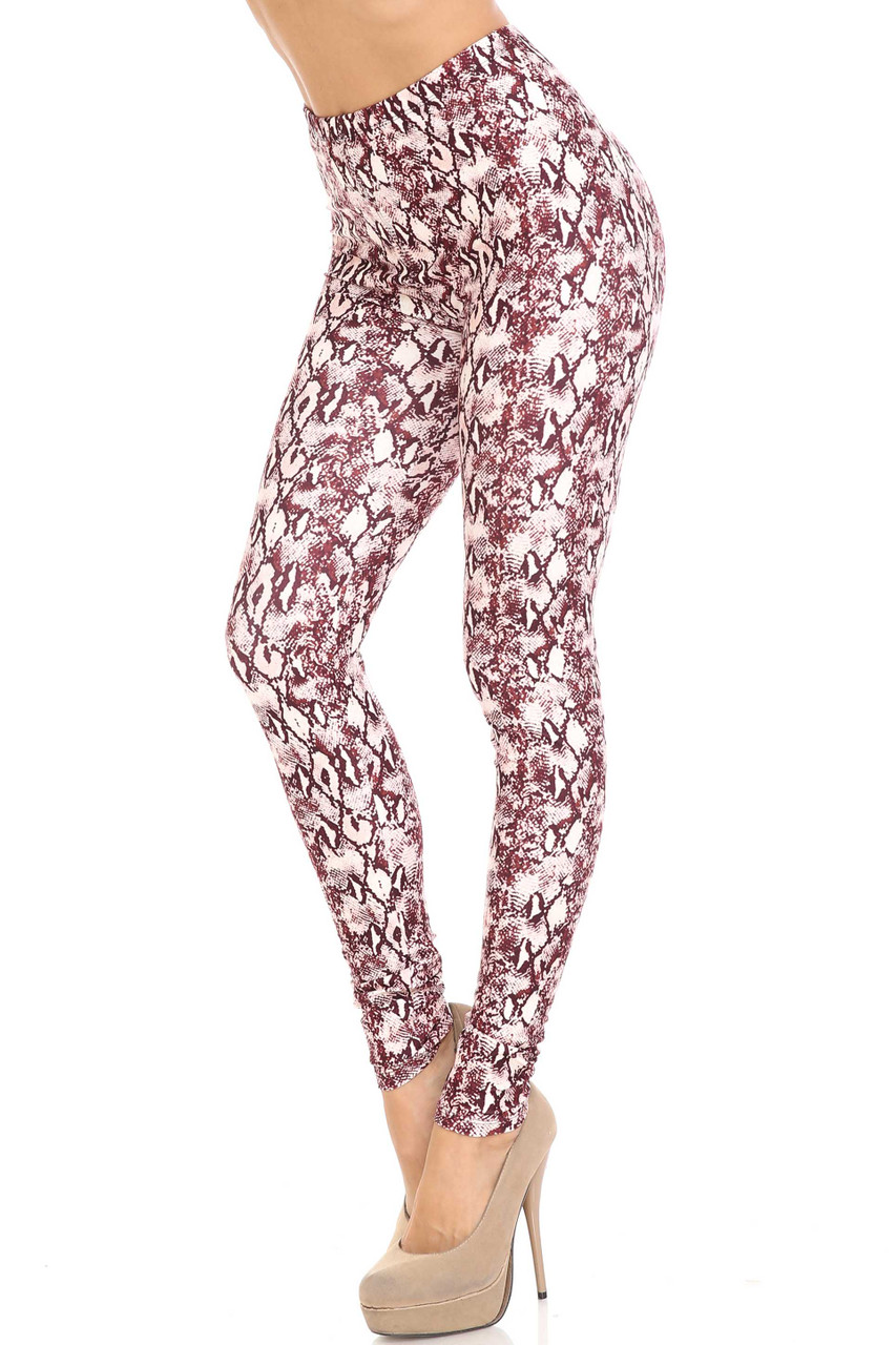 45 degree view of Creamy Soft Crimson Snakeskin Leggings - USA Fashion™ with an all over burgundy on white reptile design.