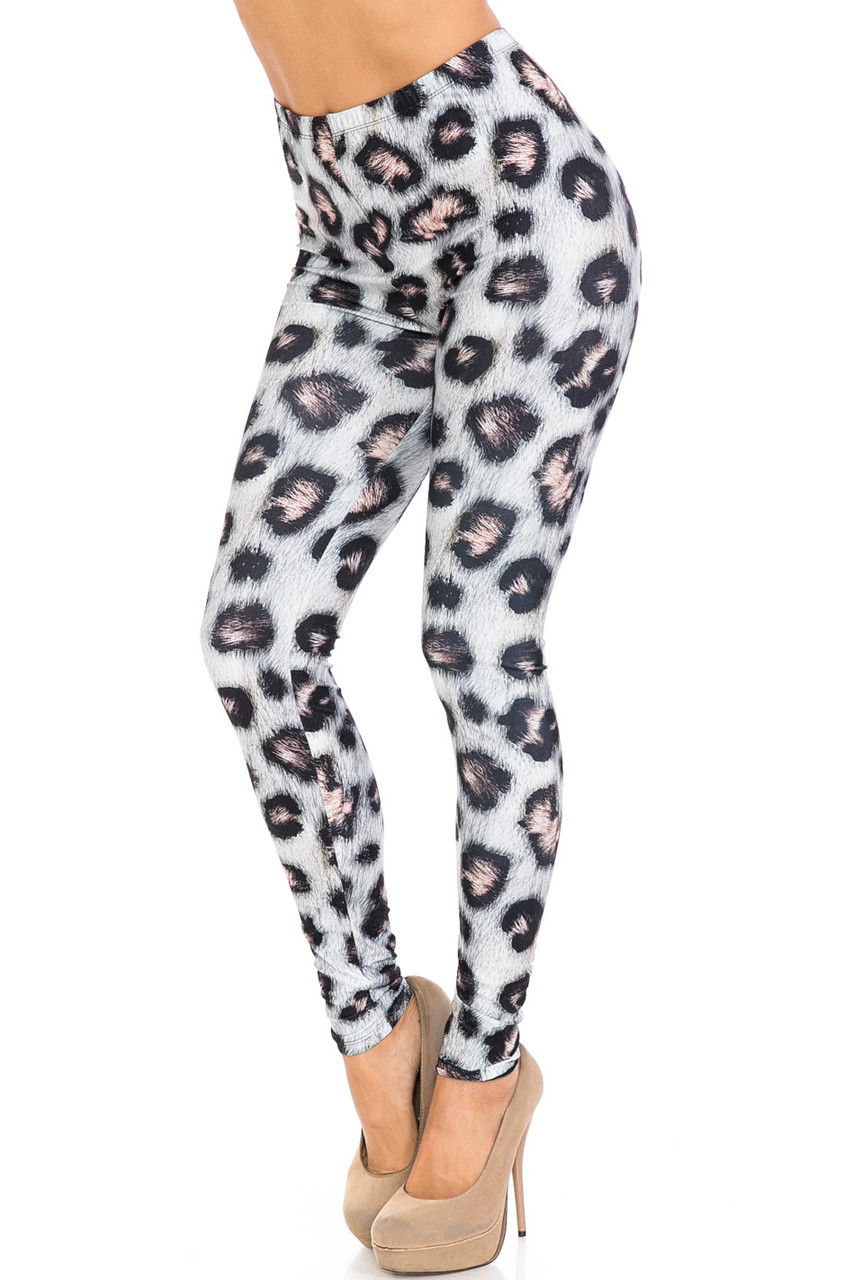 45 degree view of Creamy Soft Moda Leopard Plus Size Leggings - USA Fashion™ with an all over spotted snow leopard design with a fur texture looking print.