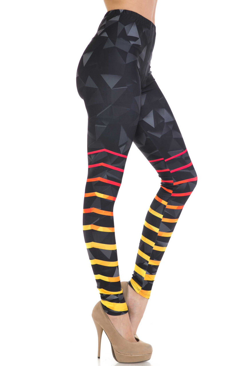 Right side of Creamy Soft 3D Harmonic Angles Leggings - USA Fashion™ with a cool black geometric design with colorful stripes around the lower legs