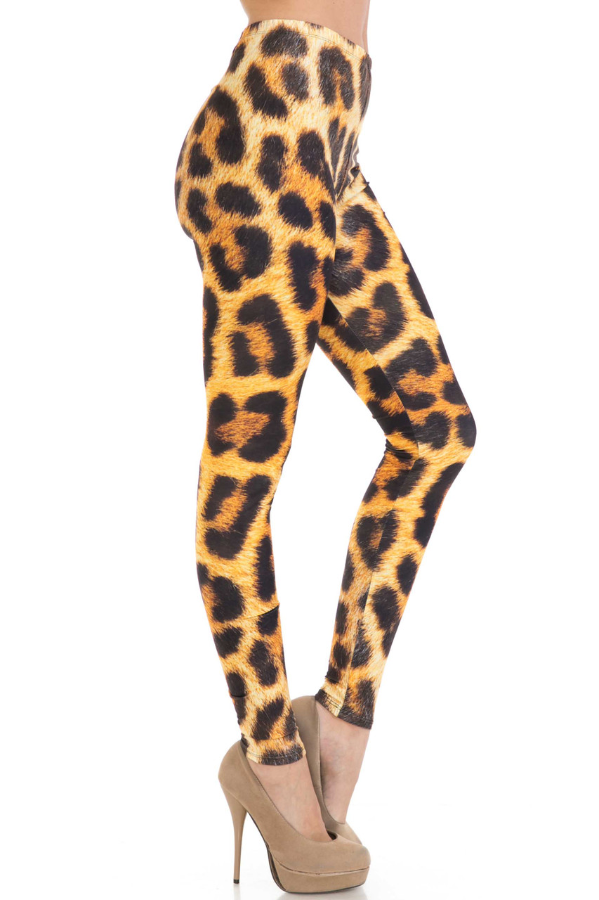 Right side of Creamy Soft Spotted Panther Plus Size Leggings - USA Fashion™ with an all over brown spotted animal design with a printed on fur texture.