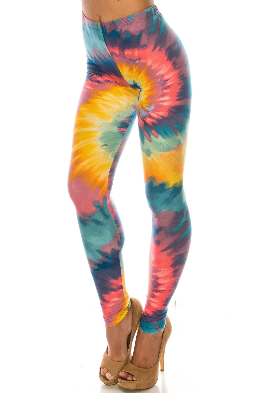 45 degree view of mid rise Buttery Soft Multi-Color-Bold Tie Dye Leggings with a comfort elastic waistband.