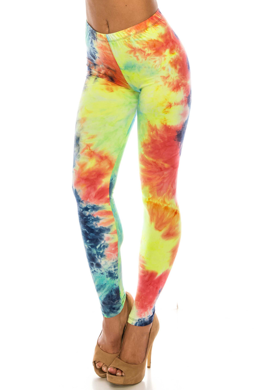 45 degree view of mid rise Buttery Soft Summer Yellow Tie Dye Leggings with a comfort elastic waistband.