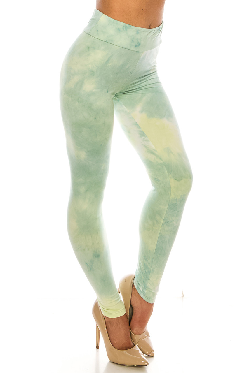 45 degree Right side view of Buttery Soft Mint Tie Dye High Waisted Leggings with a figure flattering high waist.