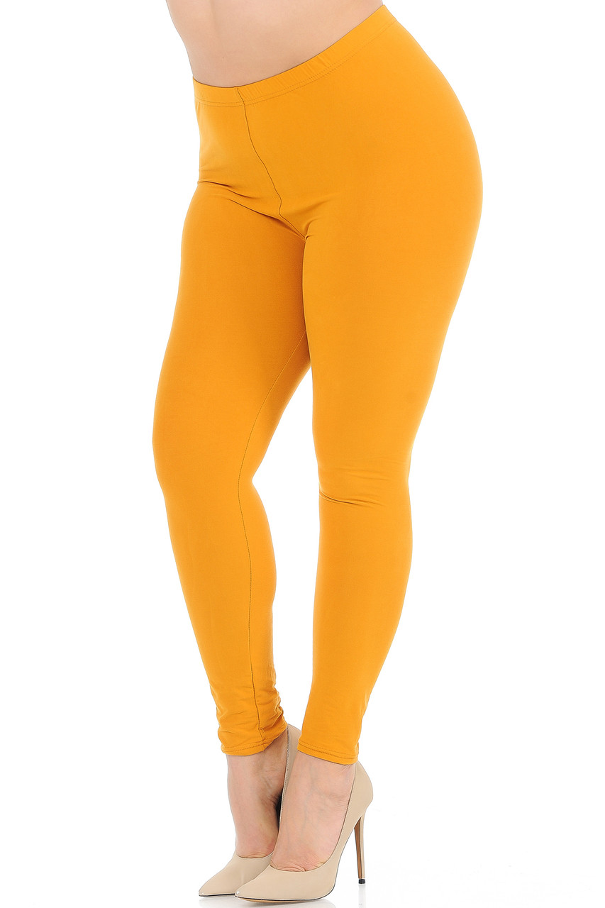 45 degree view of Mustard Buttery Soft Basic Solid Extra Plus Size Leggings - 3X-5X - New Mix