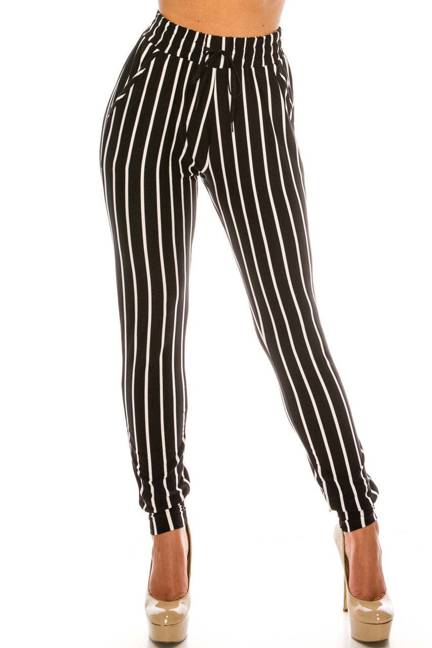 Front view of Buttery Soft Vertical Black Pinstripe Joggers with a versatile black and white striped design.