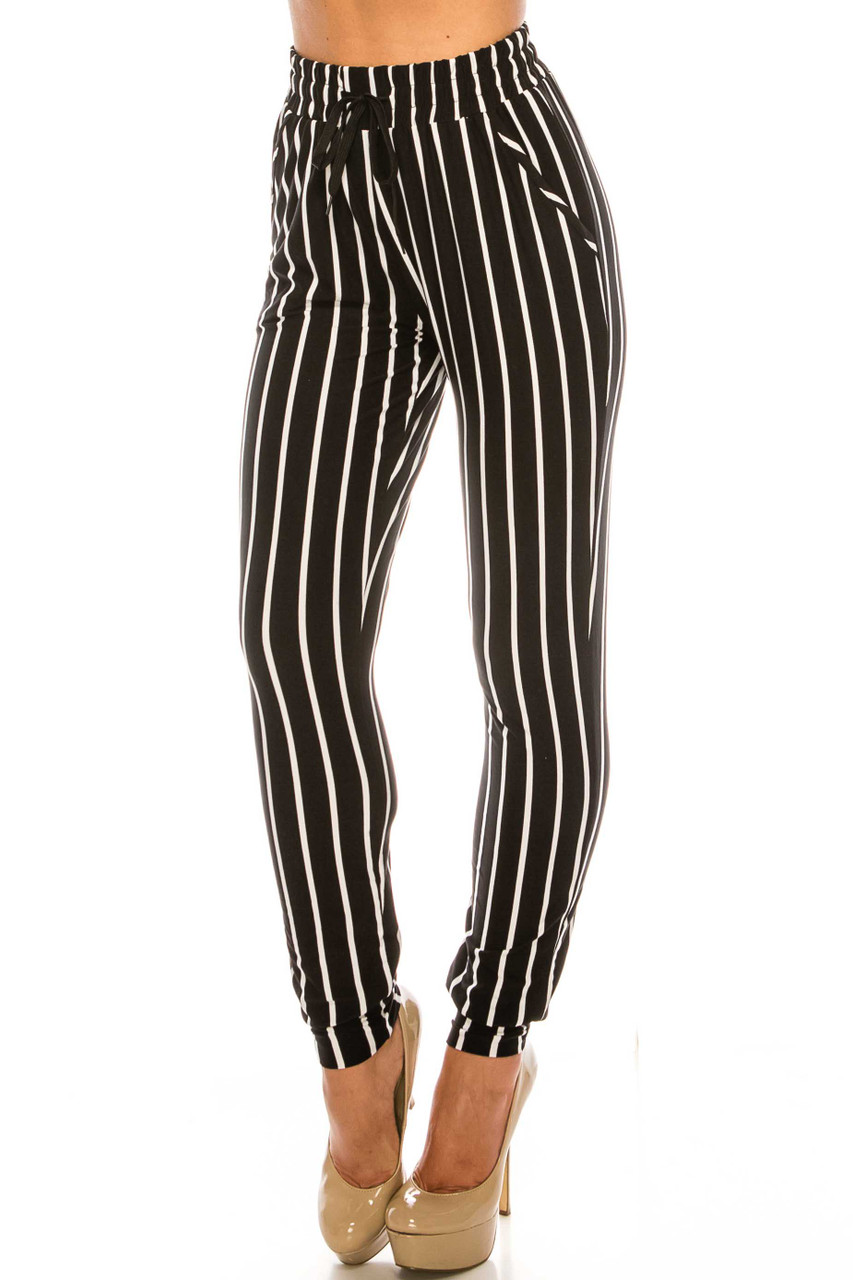 45 degree view of Buttery Soft Vertical Black Pinstripe Joggers with an elastic tie waist and pockets.