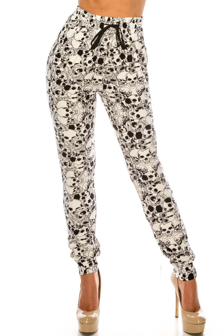 Front view of Buttery Soft White Layers of Skulls Joggers featuring an edgy black and white skeleton head design.
