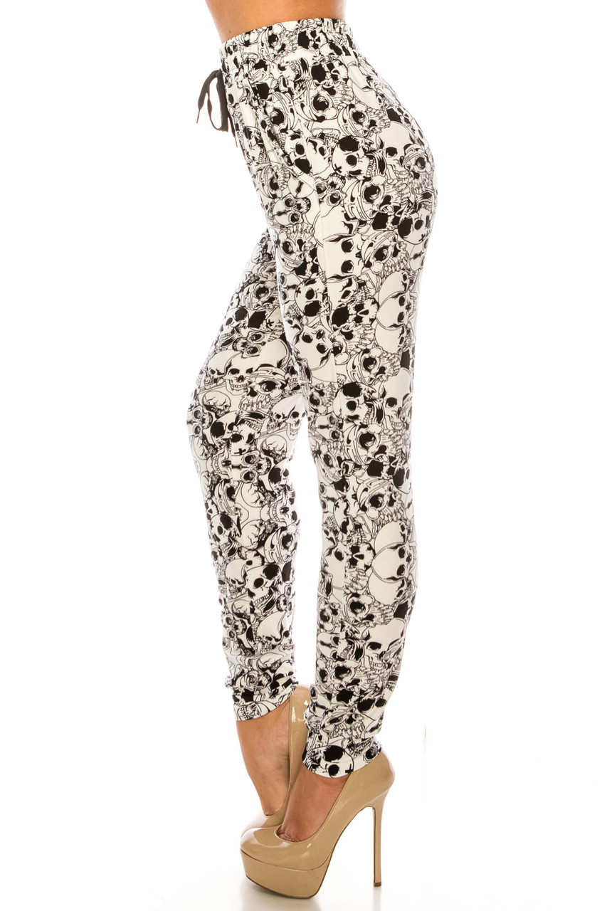Left side of Buttery Soft White Layers of Skulls Joggers