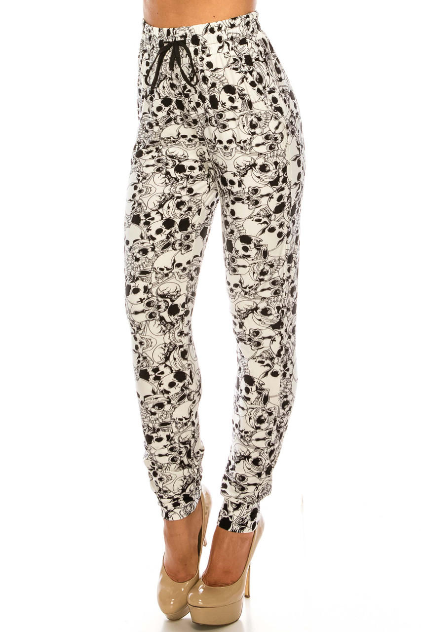 45 degree view of Buttery Soft White Layers of Skulls Joggers