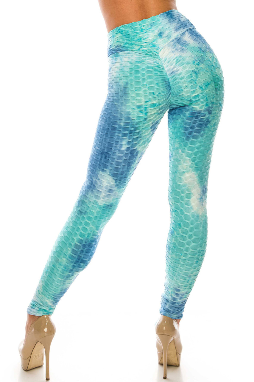 Back side image of Aqua and Blue Tie Dye Scrunch Butt Sport Leggings with ruching on the rear for a booty lifting effect.