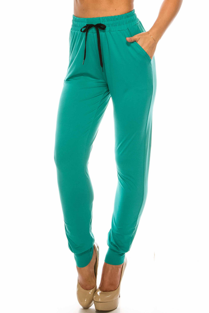 45 degree left side of Buttery Soft Solid Basic Jade Joggers - EEVEE showing off functional pocket
