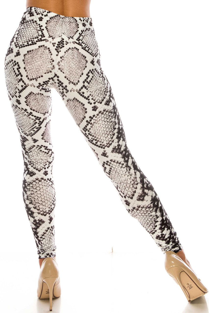 Back side image of Creamy Soft Ivory Python Leggings - Plus Size - USA Fashion™ featuring an all over white and black accented reptile print design.