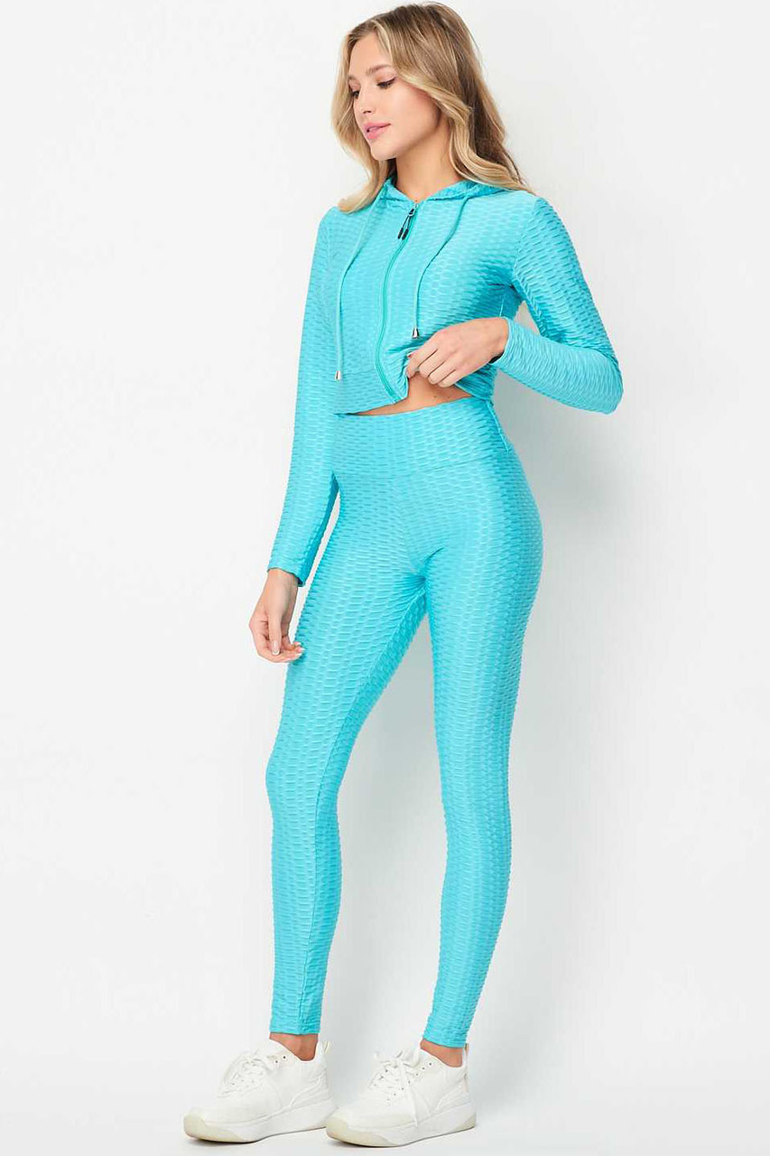Front of Light Blue 2 Piece Scrunch Butt Leggings and Cropped Hooded Jacket Set