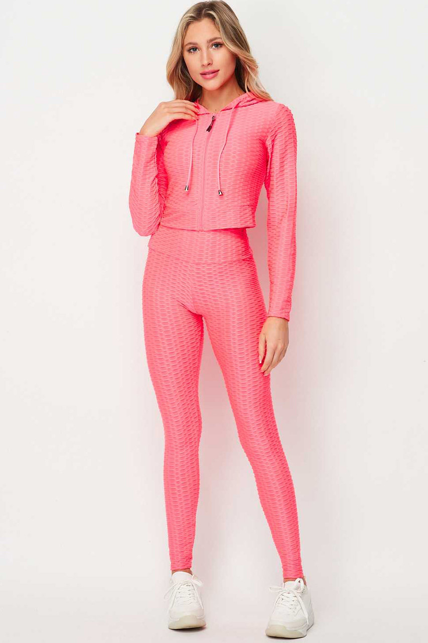 Front of Neon Pink 2 Piece Scrunch Butt Leggings and Cropped Hooded Jacket Set
