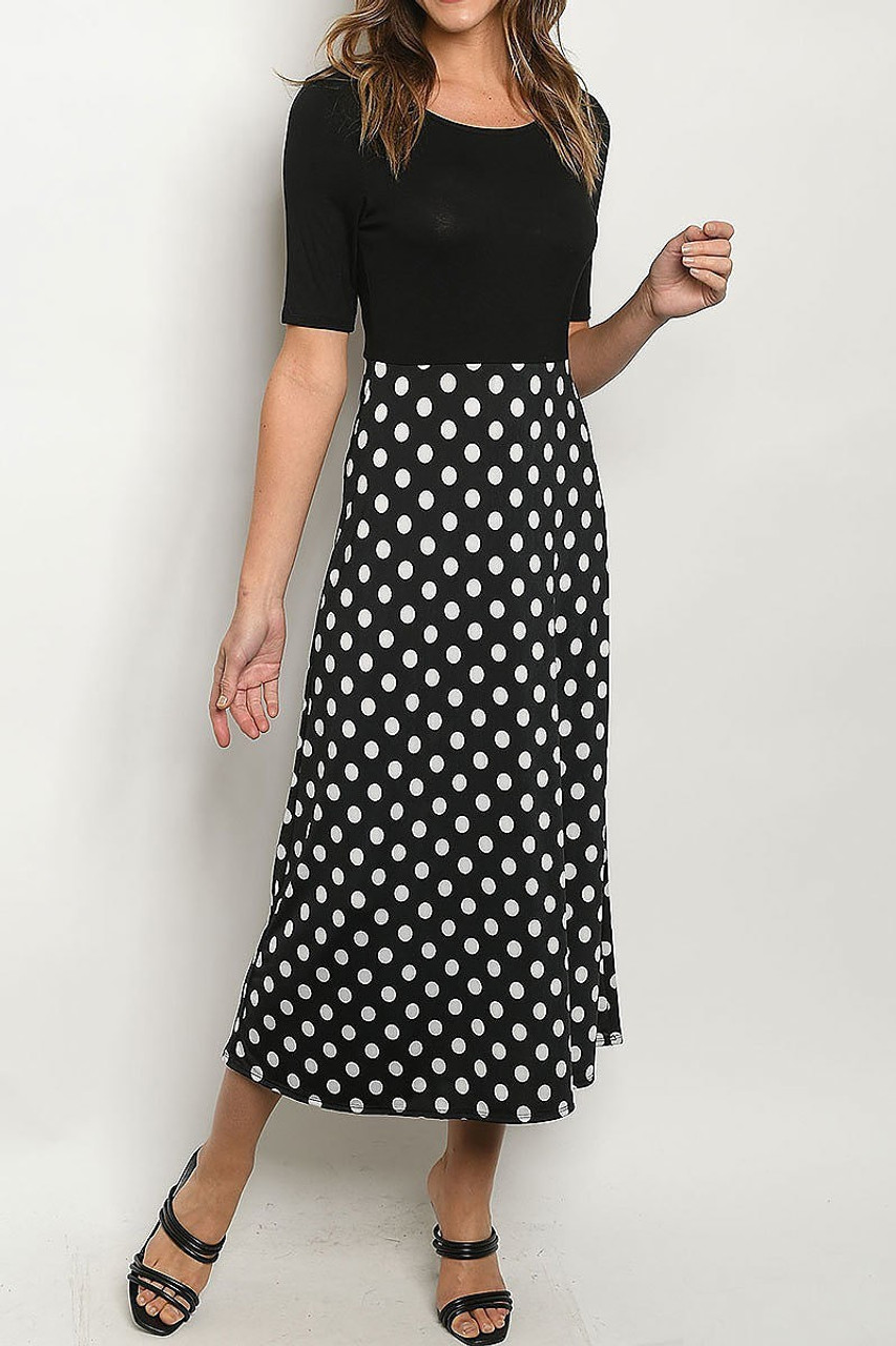 Front side image of Black Polka Dot Color Block Half Sleeve Midi Dress with a polka dotted skirt and solid top half design.