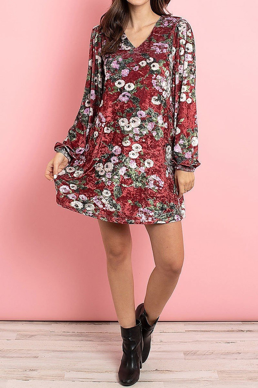 Front side image of Wine Velvet Floral Long Sleeve Gathered Cuff V-Neck Mini Dress pictured styled with black leather booties.