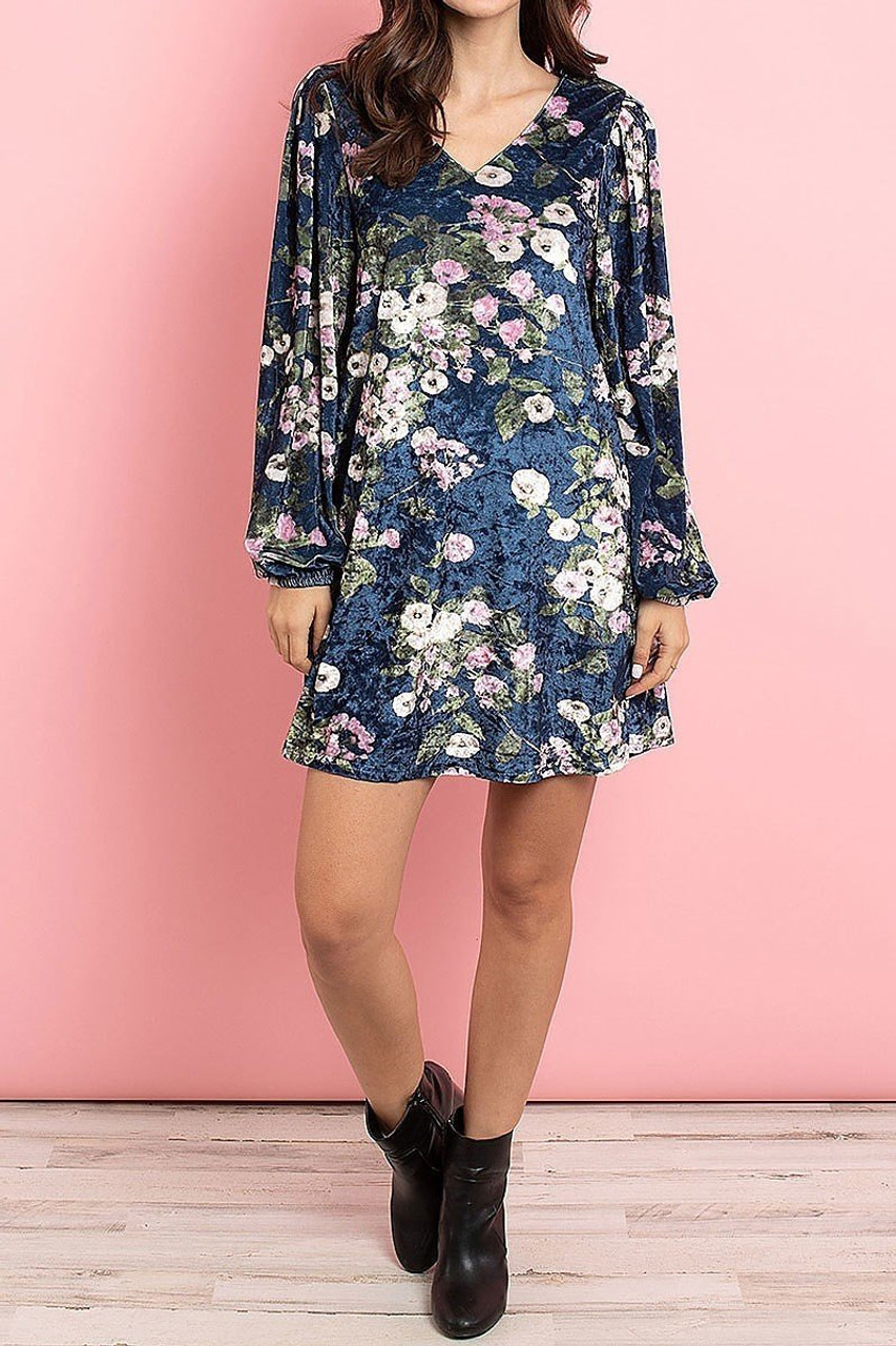 Front side image of Navy Velvet Floral Long Sleeve Gathered Cuff V-Neck Mini Dress worn with black leather booties.