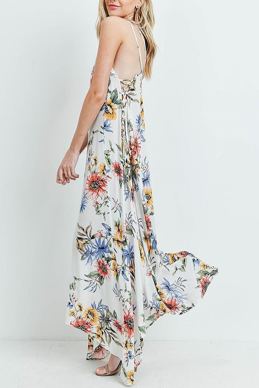 Left side of White Floral  Flounce Asymmetrical Hem Maxi Dress with Crisscross Back showing off lace up side detail