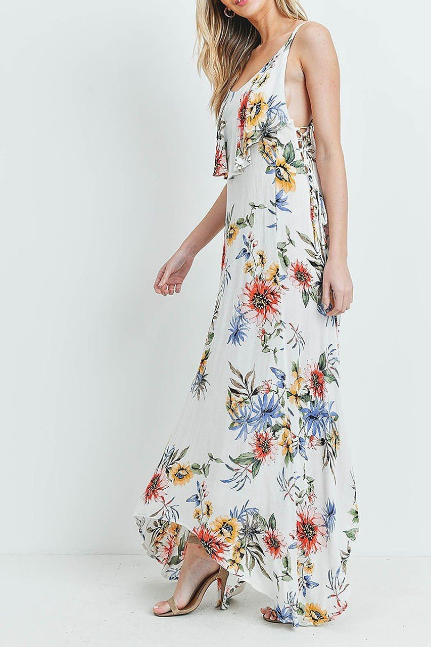 Left side of White Floral  Flounce Asymmetrical Hem Maxi Dress with Crisscross Back worn with nude heels.