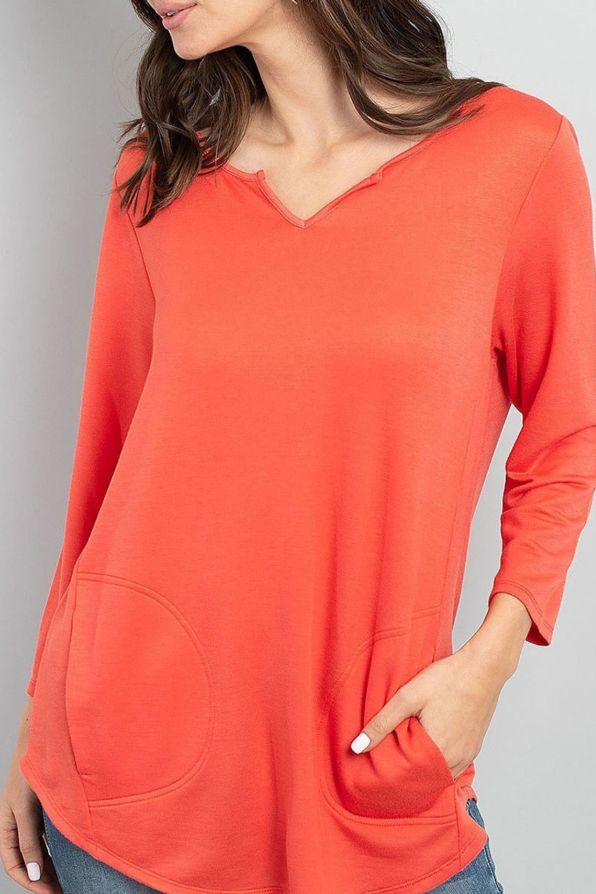 Front view of Coral Split Neck Round Hem Long Sleeve Tunic with Pockets