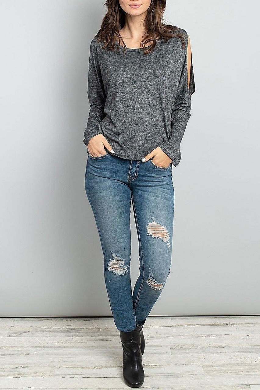 Front full modeled view of Split Shoulder Marled Long Sleeve Top shown styled with distressed jeans and black leather booties.
