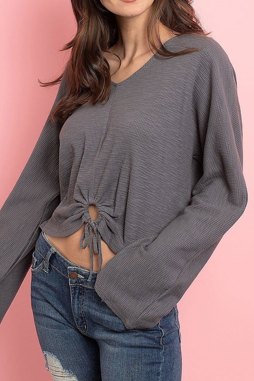 45 degree view of Charcoal Cropped Waist Tie Hem Long Sleeve Cotton V-Neck Top