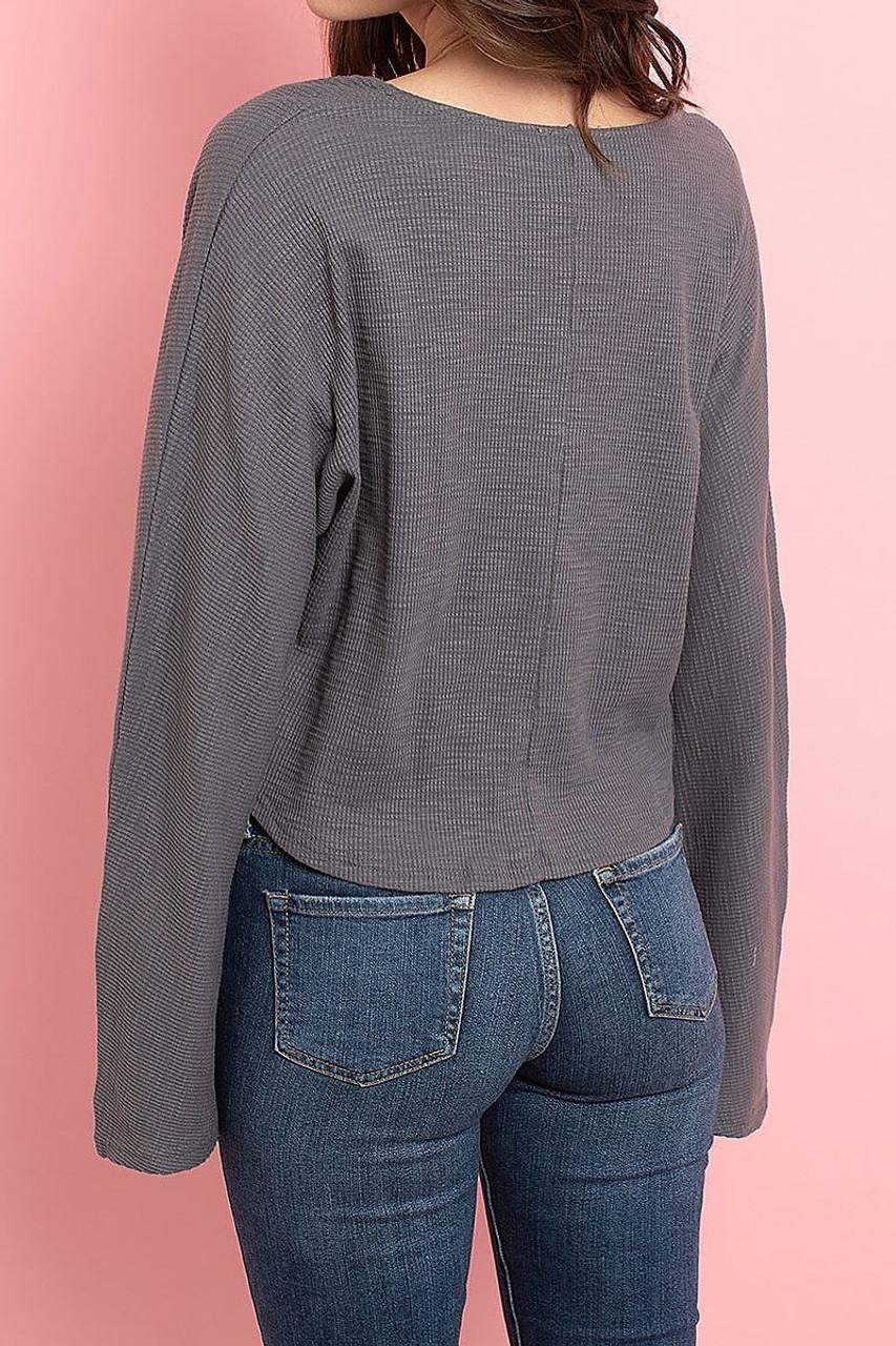 Back of Charcoal Cropped Waist Tie Hem Long Sleeve Cotton V-Neck Top