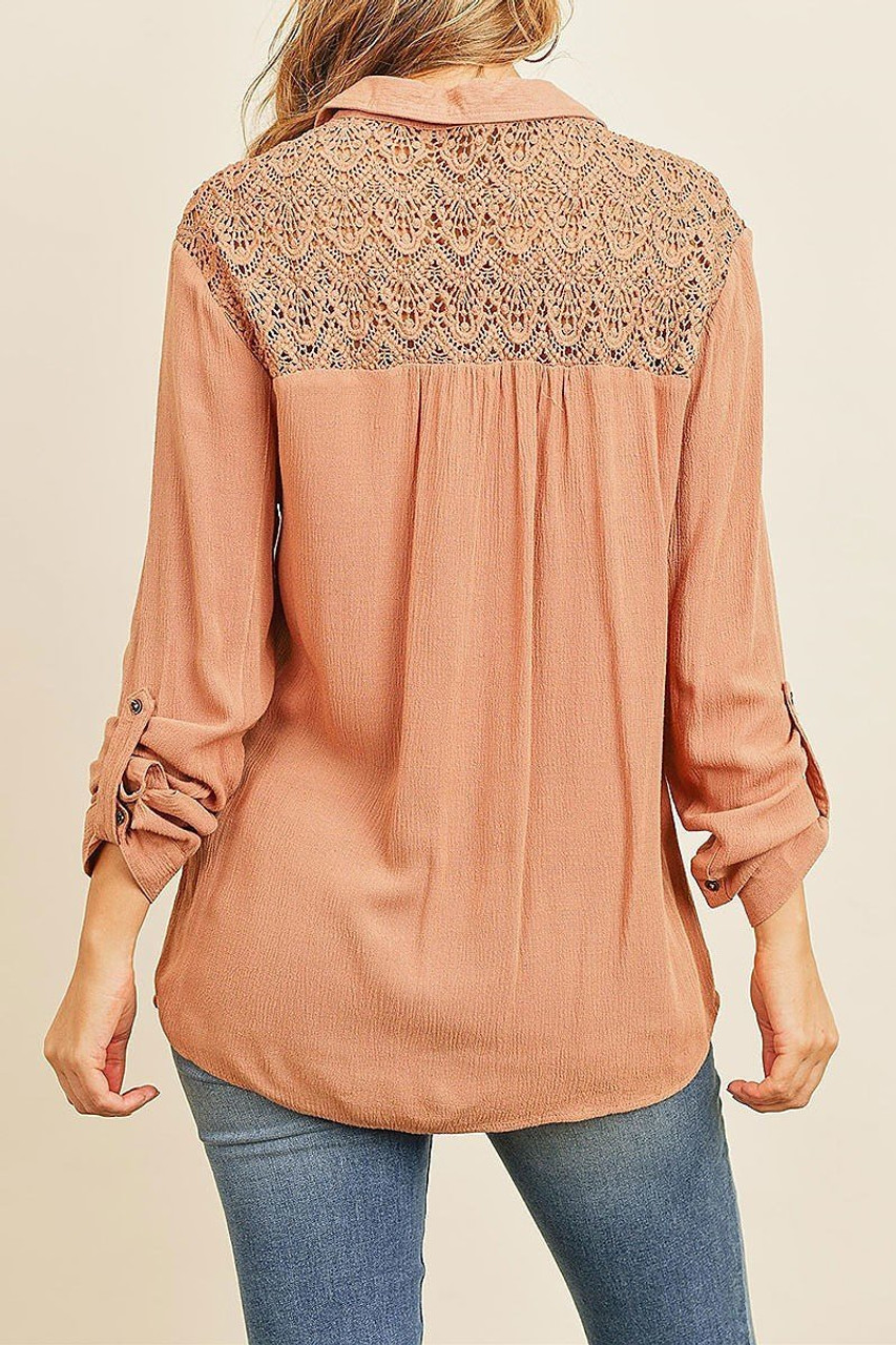 Back of Crochet Back Accent Lace Up V Neck Collared Long Sleeve Top with Front Pockets with sleeves that roll up with a button.