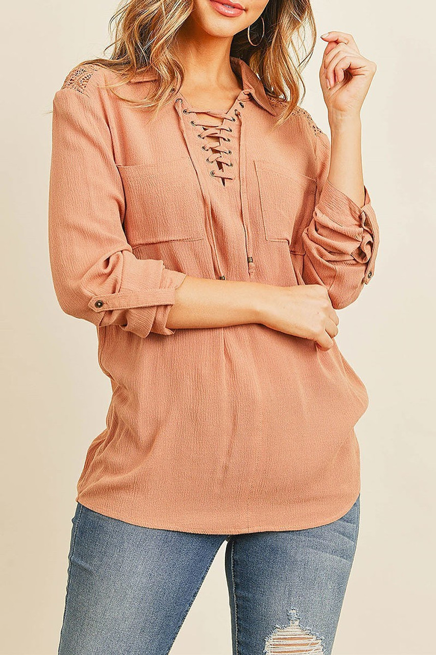 Front of Crochet Back Accent Lace Up V Neck Collared Long Sleeve Top with Front Pockets with two front pockets and tons of stylish accents.