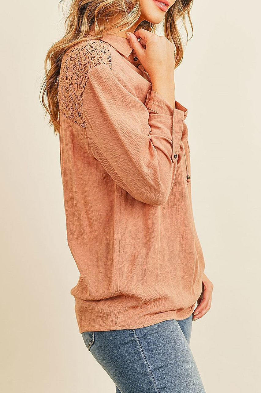 Left side of Crochet Back Accent Lace Up V Neck Collared Long Sleeve Top with Front Pockets