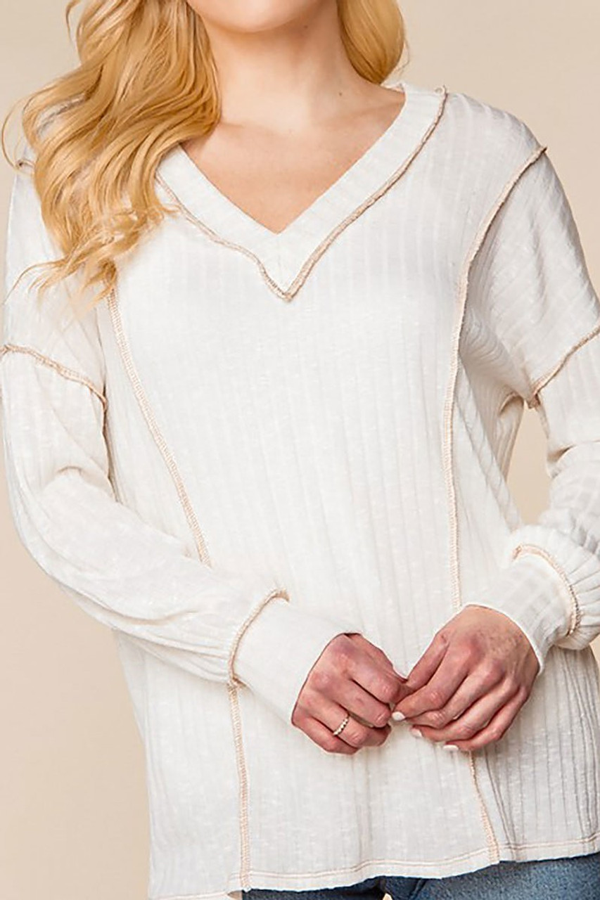 Front of Long Sleeve Contrast Outside Seam Rib Knit V-Neck Top - Plus Size with taupe seams contrasting an ivory fabric base.