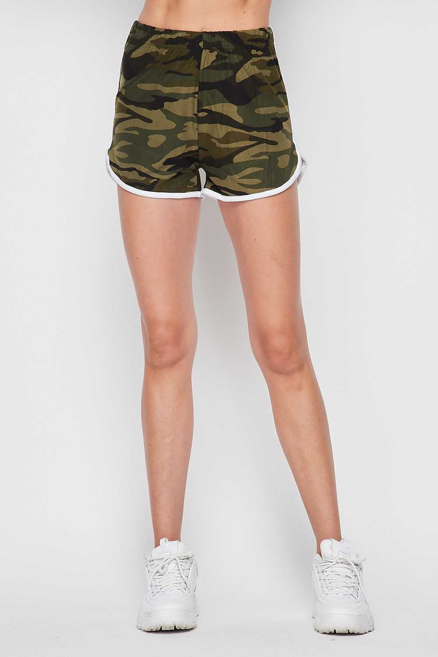 Front of Buttery Soft Green and White Camouflage Dolphin Shorts shown styled with white sneakers.