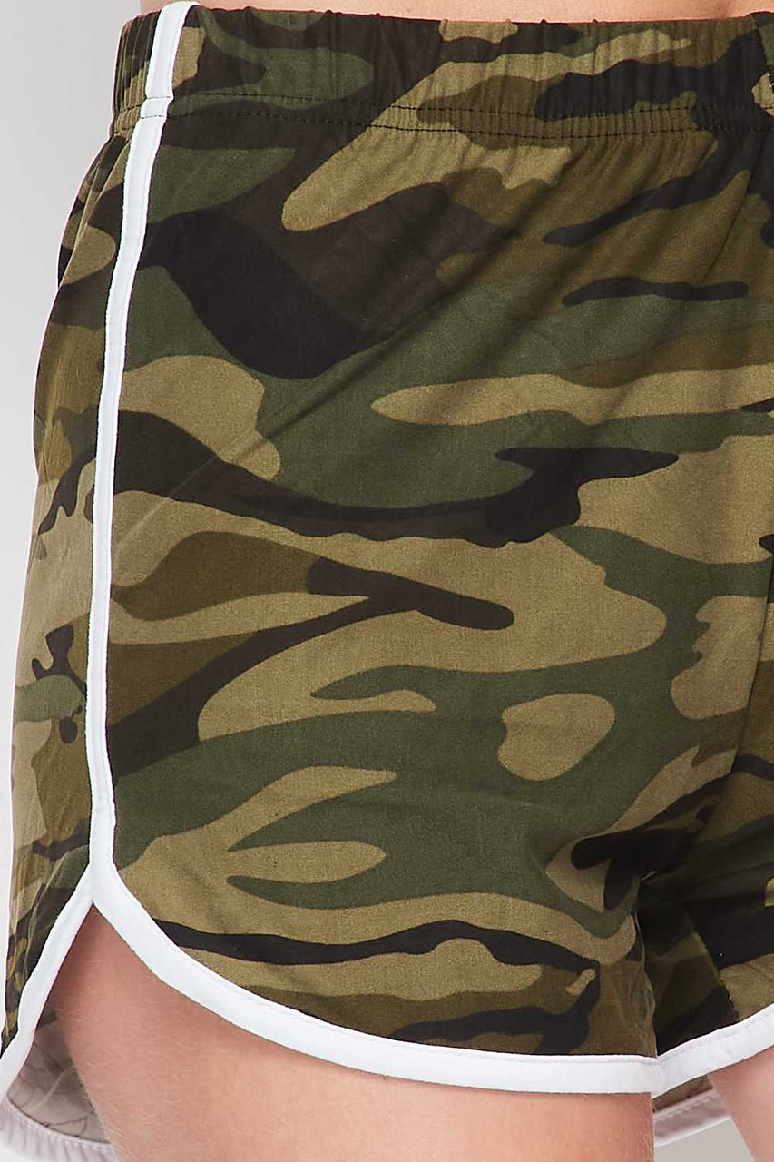 Close-up of Buttery Soft Green and White Camouflage Dolphin Shorts