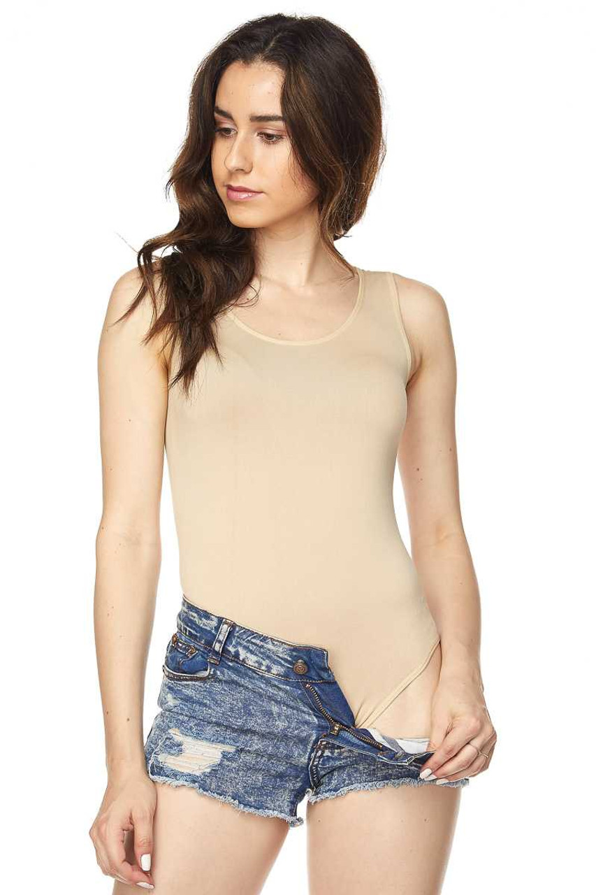 Front of Beige Seamless Basic Bodysuit with Snap Closure shown styled with denim shorts.