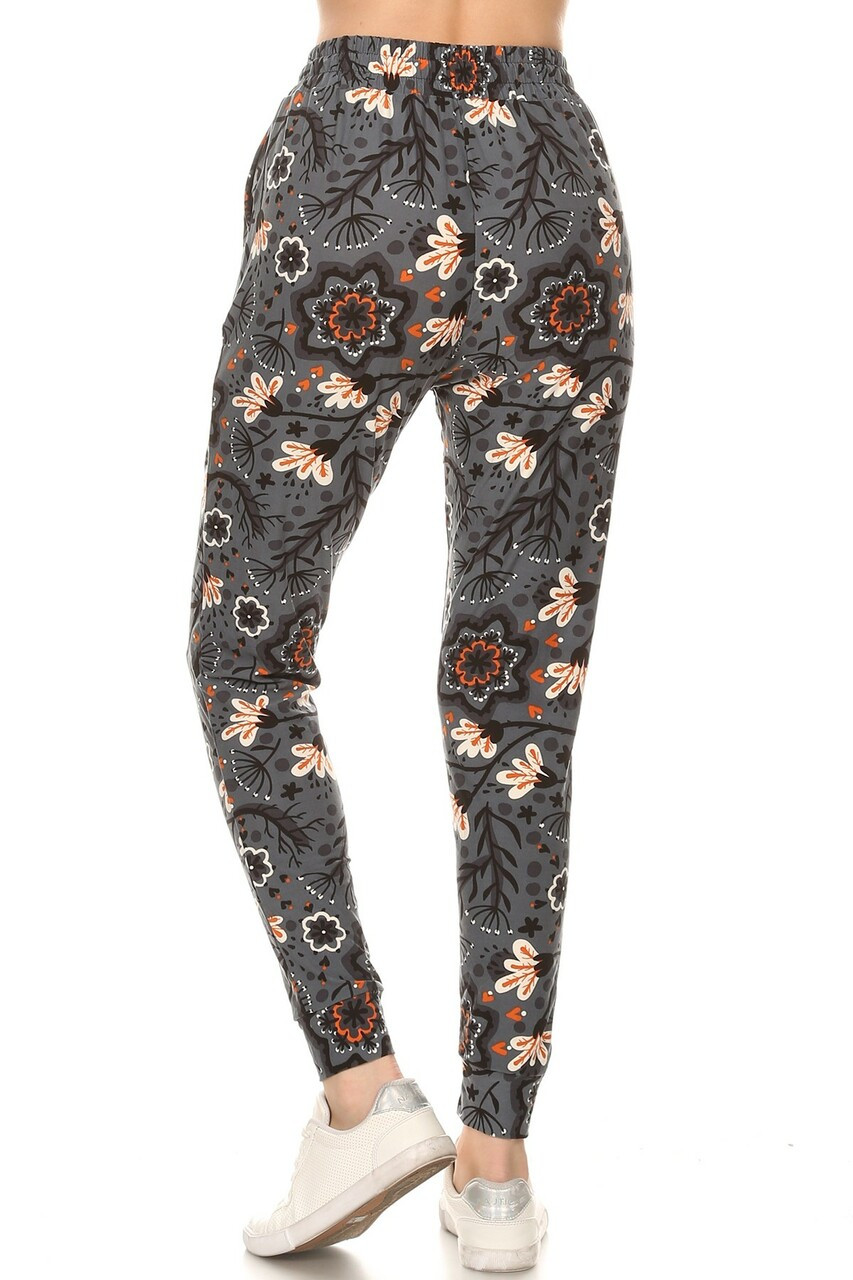 Back side image of Buttery Soft Peachy Floral Blossom Plus Size Joggers with a comfortable relaxed fit.