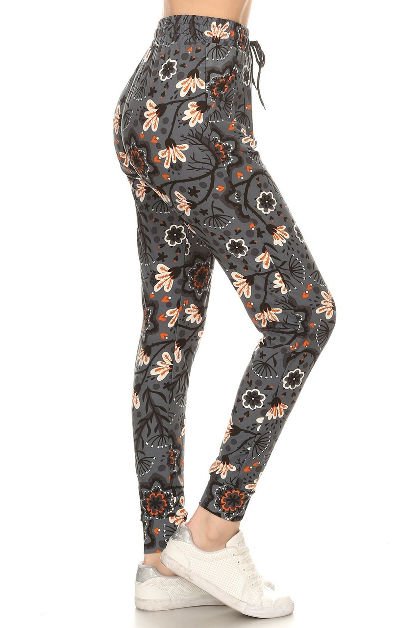 Right side image of Buttery Soft Peachy Floral Blossom Plus Size Joggers with functional side pockets and a tie string waist.