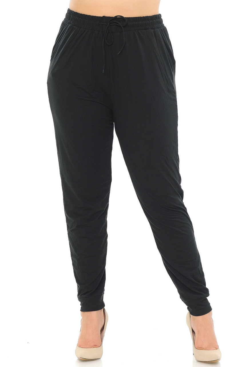 Front side image of Buttery Soft Basic Black Solid Plus Size Joggers offering a comfortable and versatile look for any season