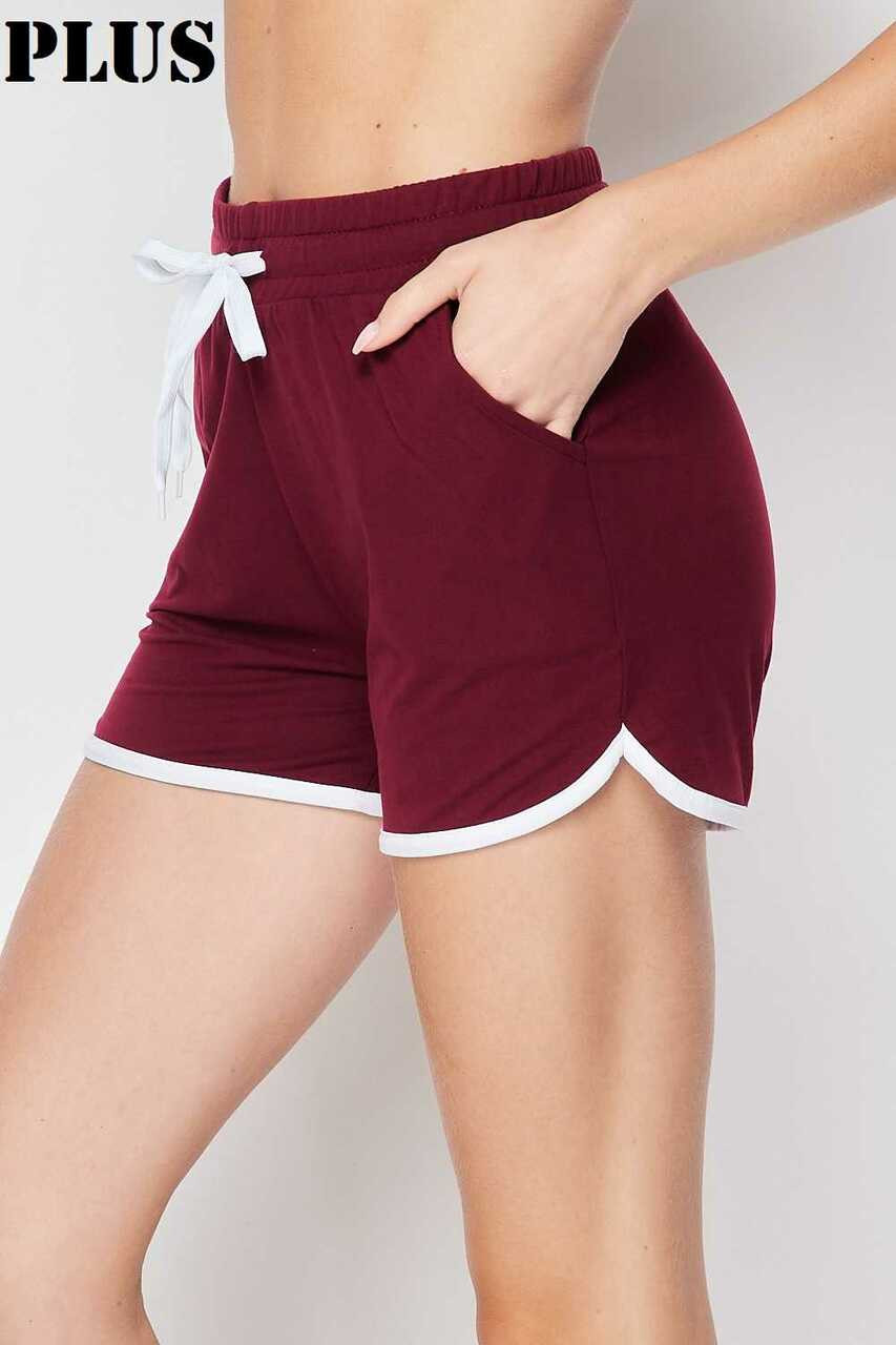 Left side of Burgundy Buttery Soft Drawstring Waist Plus Size Dolphin Shorts with Pockets