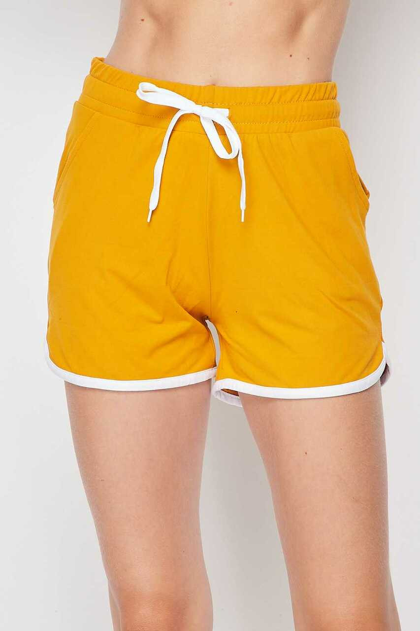 Front side of Mustard Buttery Soft Drawstring Waist Plus Size Dolphin Shorts with Pockets